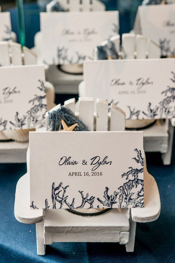 What a great favor and/or escort card holder!  These little white wooden Adirondack chairs feature tea light candles in the seat.  Perfect for a beach wedding!