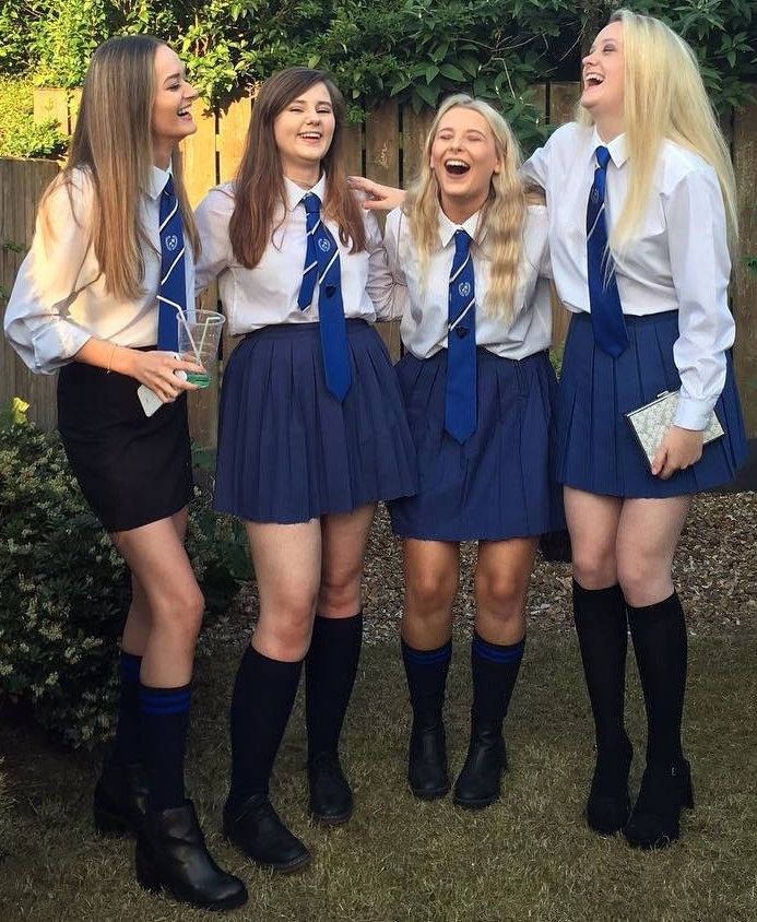 Girls Dressed In Formal School Uniforms WIth Blue Ties