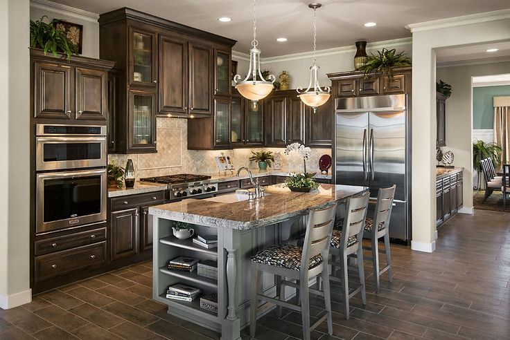 Glass Fronted Cabinets And A Contrasting Island Are