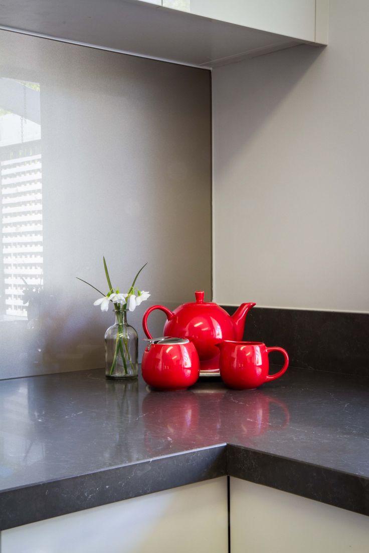 Modern kitchen. Glass splashback. Red accessories. www.thekitchendesigncentre.com.au