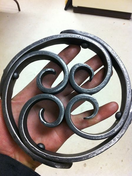 Hand Forged. Invert the swirls to make a liburu