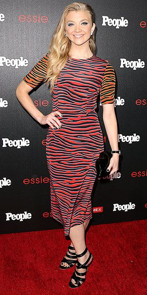 "NATALIE DORMER Another one of PEOPLE's ""Ones to Watch"" ensures you can't miss her at the L.A. bash, thanks to the two-tone House of Holland zebra-stripe sheath she wears with strappy black heels and her ""Hunger Games"" half shave."