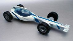 "Here are a few photos of my sons final Pinewood Derby car which he named the ""Kinship."" It finished 1st in a pack of approximately 90 cars.  Each car we have built has had special meaning and I"