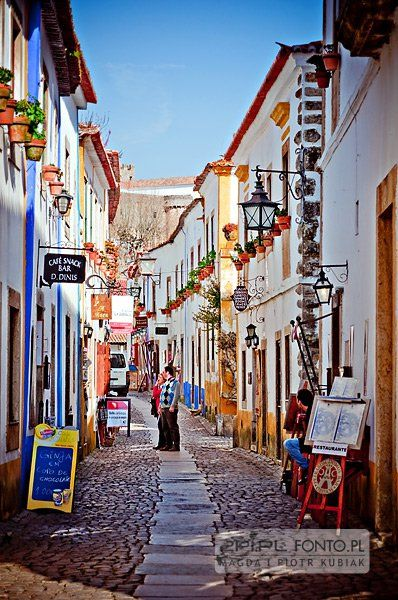 """Obidos, Portugal -- Each July Óbidos castle hosts a traditional Medieval Market.  Spit roasted hog, hearty soups, rabbit, lamb, cod, quail, sausages and other grilled meats are just some of the many medieval style meals on offer from dozens of """"taverns"""" and stalls spread throughout the market. Drinking from pewter tankards and eating from wooden trencher all adds to the experience."""