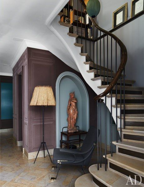 A staircase leads from the master bedroom down to a dressing area and bath | archdigest.com