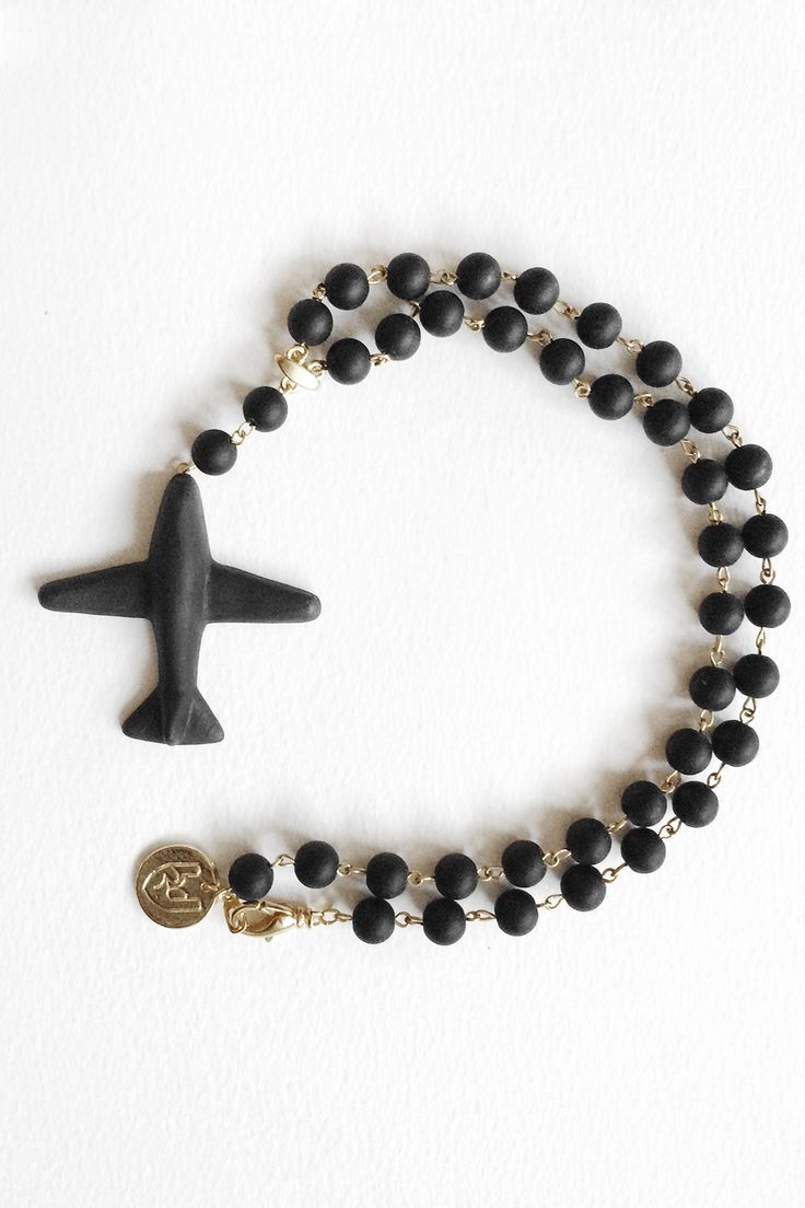 Plane'n'love. Necklace Love is in the air. Come fly with our porcelain airlines. Rise above the clouds, reach the sky and leave your worries behind.  #porcelain #porcelainjewelry #rocknheartporcelain #ceramicjewellery #фарфор #black