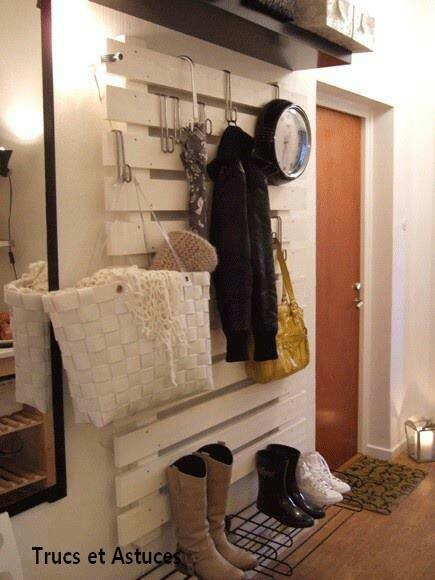 Coat rack made from a pallet and some hooks. Totally making this!