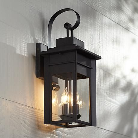 "Bransford 21"" High Black Iron Outdoor Wall Light Fun light...I like this but again, wouldn't work by the front door but could work by the other garage/outside door lights."