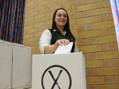 St. Benedict's Catholic Secondary school student Alyssa Cheff votes for her choice of mayor, councillor and school trustee in a parallel student election.