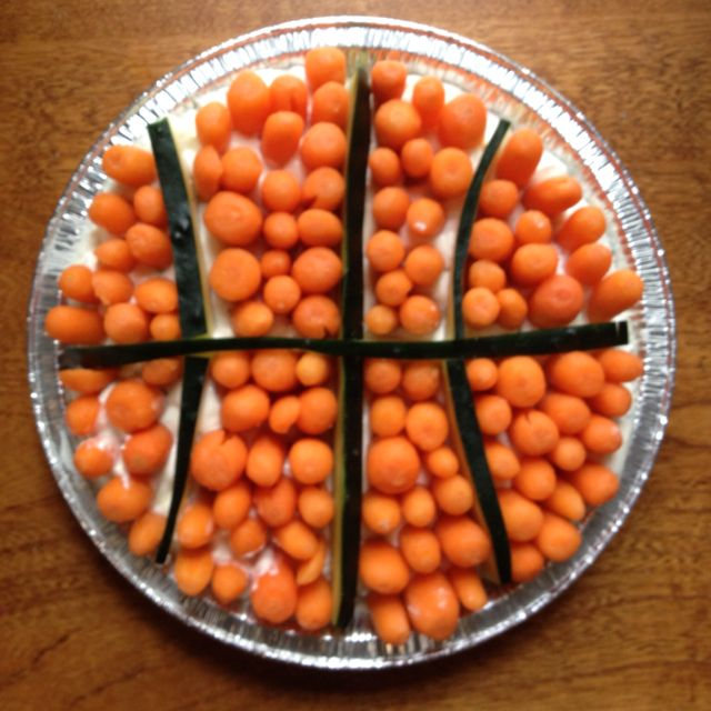 Thanks to the Dillons ( Kroger ) ad for this cool idea! Great idea for March Madness party! It was easy!! Ranch dip on bottom, cucumber for outline and carrots for ball!!