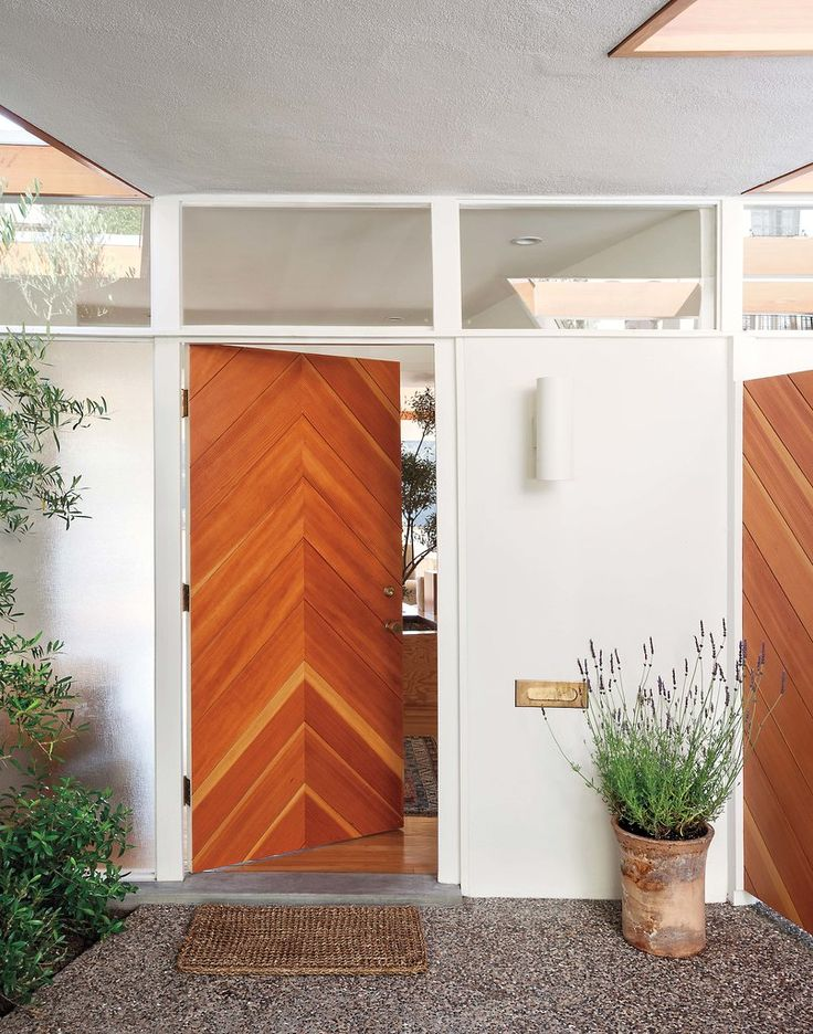 A chevron door crafted from Douglas Fir fits perfectly with the home's earthy midcentury aesthetic.