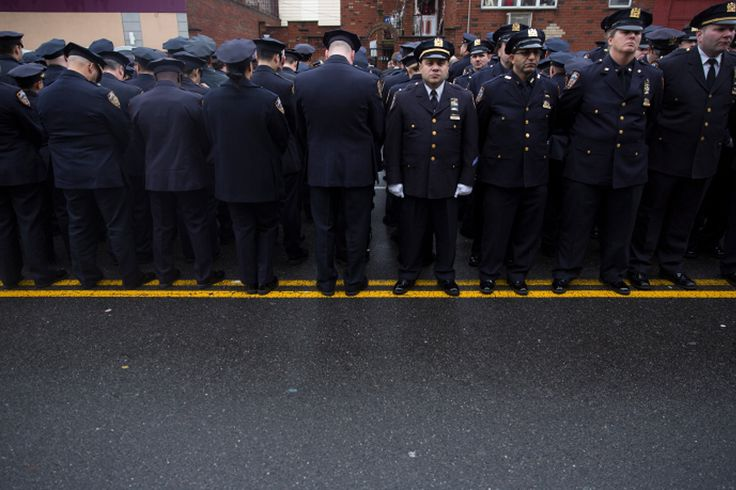 Some police officers in the crowd outside the funeral home turned their backs as Mayor Bill de Blasi... - Damon Winter/The New York Times