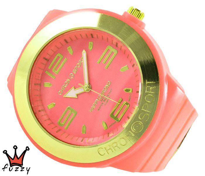 Γυναικείο νεανικό σπορ ρολόι, με κάσα σε σωμόν και χρυσό χρώμα και μεγάλα νούμερα στο εσωτερικό του.  Πλαστικό λουράκι σε σωμόν χρώμα. Διάμετρος καντράν 52 mm