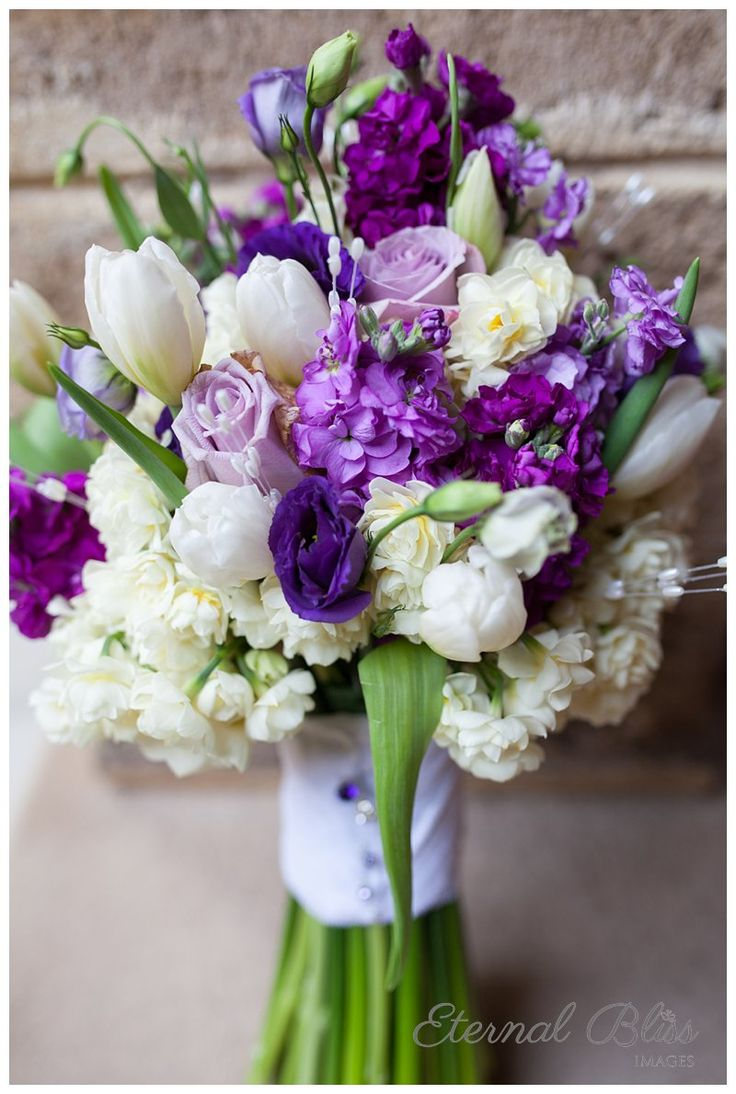 Stunning bouquet with purple and white flowers, including roses, tulips, and a whole lot of other beautiful blooms