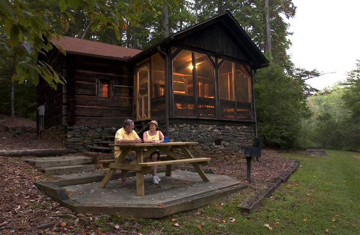 Oconee State Park has 19 cozy cabins available for rent. Thirteen cabins overlook the lake while six are in a secluded wooded area of the park. The park is located near Walhalla, South Carolina.