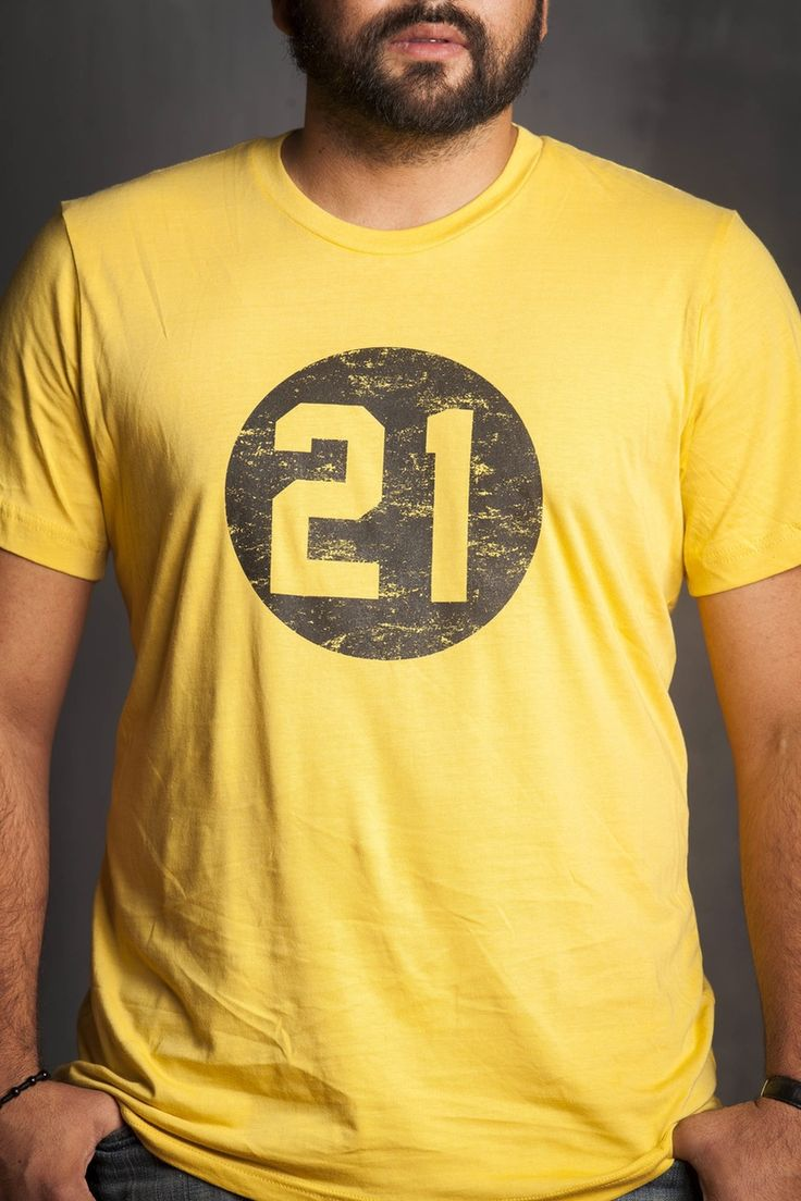 Clemente 21 logo screen printed on vintage mustard yellow, pre-shrunk cotton blend shirt. Made exclusively for the Clemente Museum by Steel City...