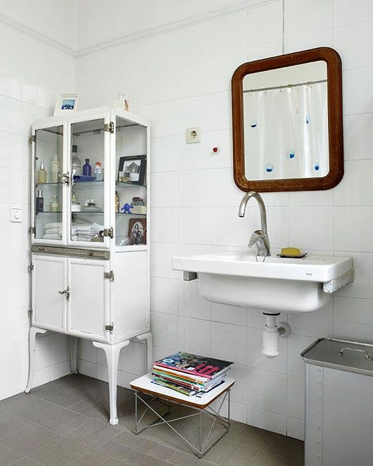 I love the idea of a vintage medicine cabinet in the bathroom - super storage and high on style!