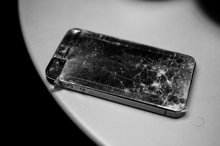 The iPhone of Mathias – epic cracked glass after the iPhone crash of the century.     Scotch-taped to avoid splitter in finger tips.