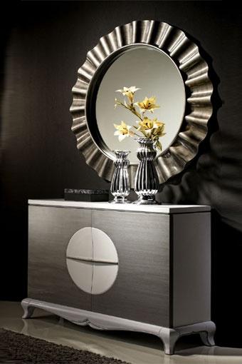 Moderno mueble recibidor con espejo también circular que proporcionará un aire sofisticado a la entrada de tu hogar. Disponible en blanco y negro.