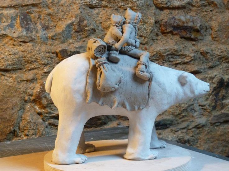 Raku sculpture - polar bear with two eskimo travellers - pre firing
