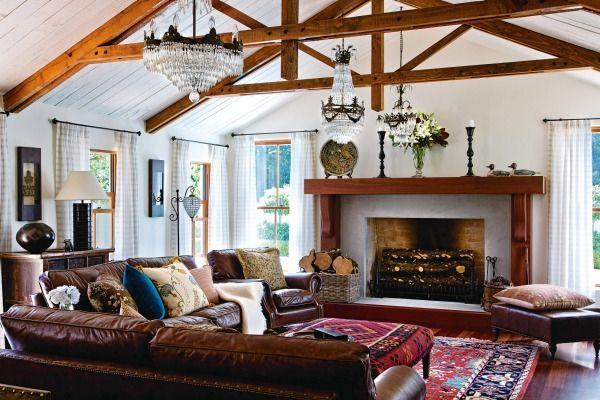 The open-plan living area of Ross and Jacqui Crowe's Kapiti Coast house features a mix of 19th century French crystal and reproduction chandeliers along the length of the room; they're delighted with their new oversized fireplace, which required extra piles to support its weight; a pair of decoy ducks sit on the 3m-long mantel.