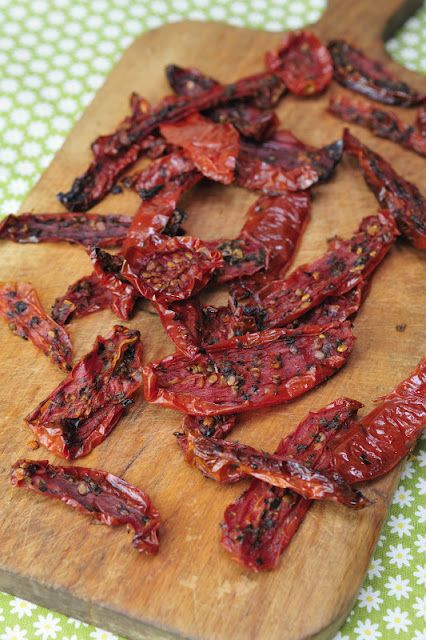 "Homemade Sun-Dried Tomatoes  I feel the whole ""preheat oven to 350"" direction kind of immediately defeats the purpose of ""sun-dried"" tomatoes but hey, I'll do it anyways :)"