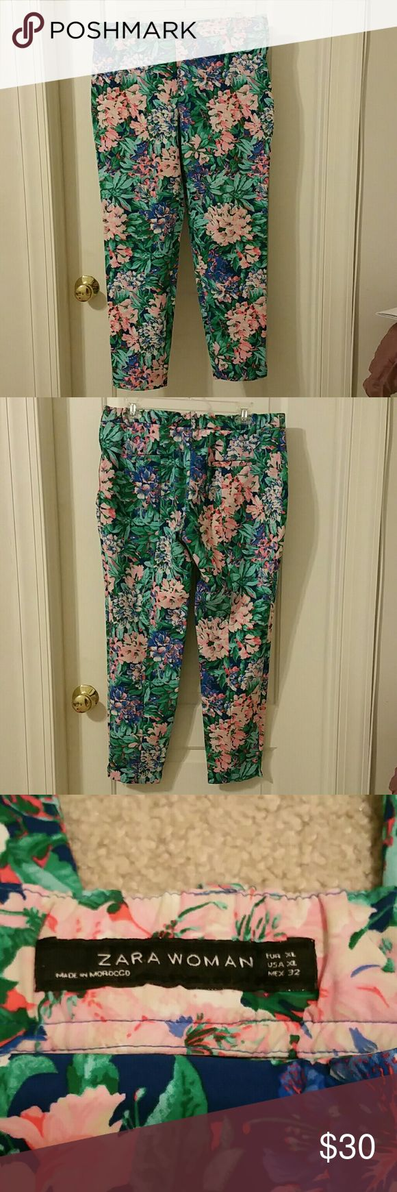 """Zara Woman Floral Trousers Size XL Very pretty floral print trousers with elasticized back, hidden side zipper and a small slit at the bottom on the sides. Belt loops and no pockets. Not sure what the material is because tags are missing. It is a nice thick material with some stretch to it. Waist 17"""", rise 10"""", inseam 27.5"""" and leg opening 6"""". Excellent condition, no signs of wear.  NO TRADES  NO PAYPAL Zara Pants Trousers"""