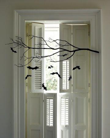 A tree branch + construction paper bats