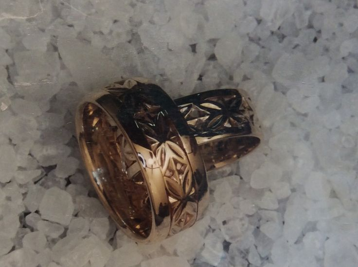 His and Her rings featuring carved Polynesian flower desighn