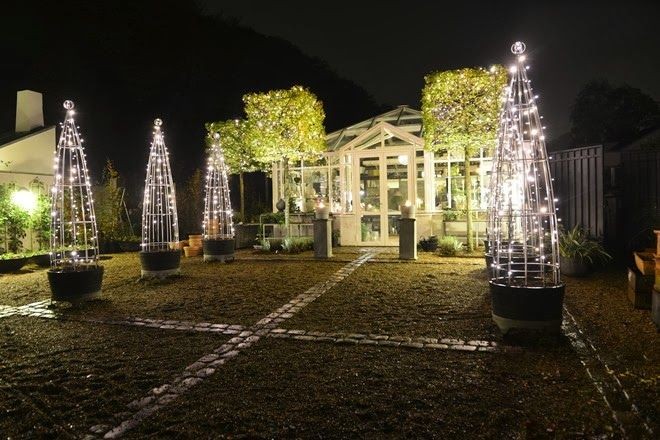 Claus Dalby's Danish garden, decorated for Christmas. The tuteurs strung with lights are a fun idea.