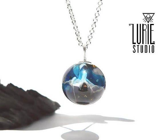 Stunning blue swirled resin sphere pendant Resin sphere