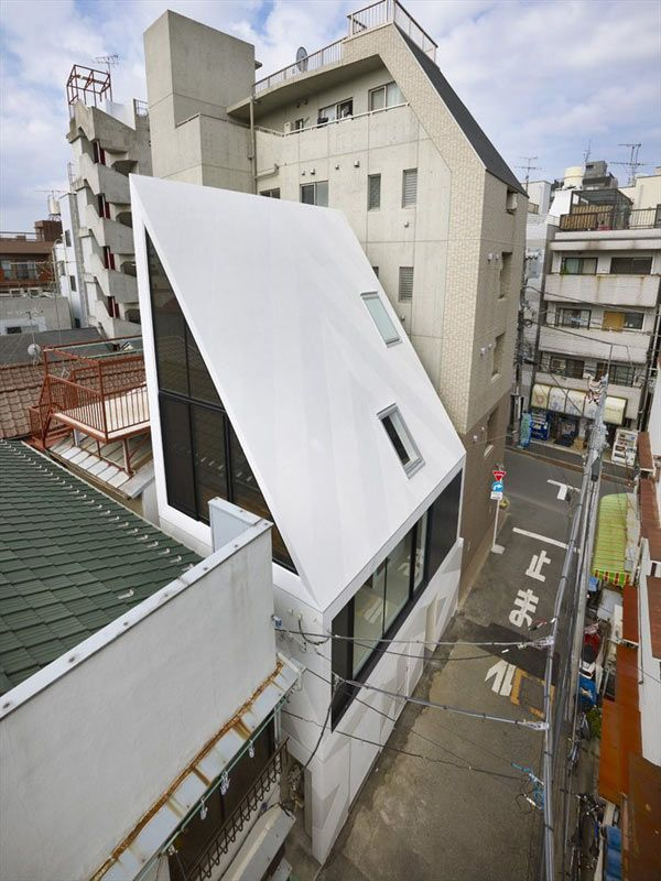 """v-architecture-photos: """" Angled roof house stands out in the city. The XYZ House, by modern Japanese architects Naf Architect and Design Inc """""""