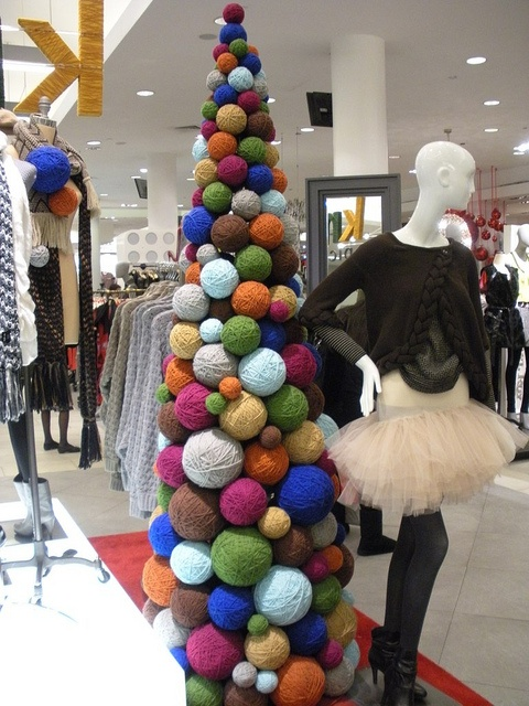 wonderful yarn display @ macy's. I did this when I worked at Gap. You roll yarn on top of some crumpled newspaper or tissue paper so you don't have to use as much yarn. Looks great when you're done.