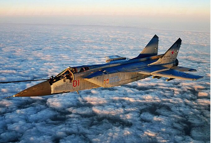 A Russian Air Force Mig-31BM soars high above the clouds.
