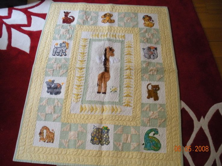 Cot quilt for Callum featuring machine embroidery and applique. This was my own design and completed in 2008.