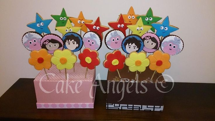 Dora the Explorer Cookie Bouquets featuring Dora, Diego and Boots the Monkey.  For a 1st Birthday Celebration for twins.
