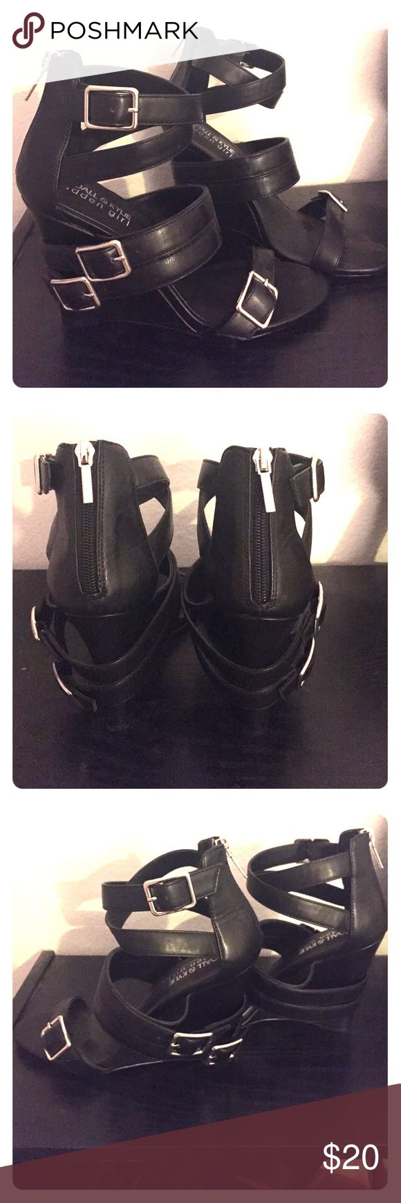 Kendall and Kylie size 8.5 wedges Kendall and Kylie size 8.5 black wedges. Patent leather, strappy front, statement buckles on side of shoes, and zip up back. Purchased from Nordstrom rack, never worn. Kendall & Kylie Shoes Wedges