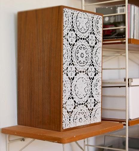 Cover a speaker with a decorative doily (that speaker is old & huge..but it would still look cute on a small speaker).