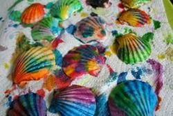 When I saw this I thought they were broken crayons that had been melted in sea shells (they're actually painted) I wonder if the shells would hold up in the oven?  will have to try.