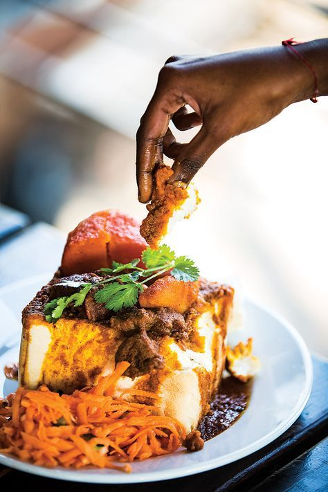 If you're the kind of person who always mops up leftover pasta or pan sauce with extra bread, consider bunny chow, the curry that's a staple of Durban, South Africa's Indian community. The best part of this spicy lamb braise? Once you're done with it, you get to eat the bread bowl it's served in.