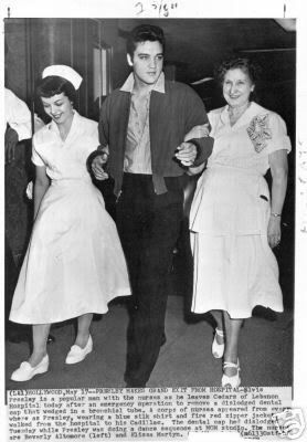 "May 1957 - ELVIS MAKES GRAND EXIT -- Elvis Presley is a popular man with the nurses as he leaves Cedars at Lebanon Hospital in Hollywood after an emergency operation to remove a dislodged dental cap that wedged in a bronchial tube. (during filming of ""Jailhouse Rock"")"