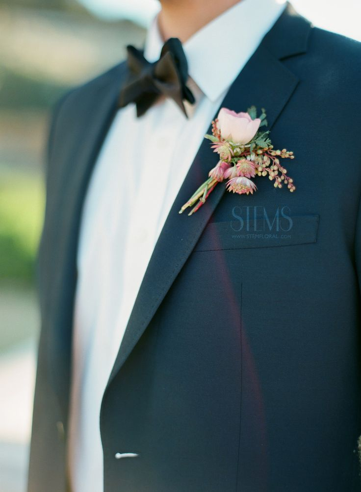 The groom's boutonniere will be a simple, ivory spray rose with pink snowberries and jasmine leaves wrapped in mint velvet ribbon with the stems showing.