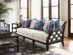 British colonial  Plantation Decor.Adoring the blue and white accent pillows.