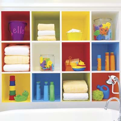 Open cubbies, which repeat six paint shades of  stripes that ring the room, frame the tub with color and stand in for a linen closet in this child's bathroom.    Photo: Alise OBrien   thisoldhouse.com