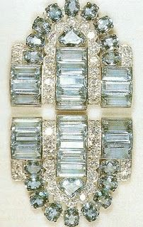 Aquamarine Cartier clip brooches, an 18th birthday present to the future  Queen (Elizabeth II) from her parents.