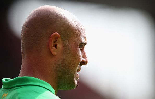 Pepe Reina Photos Photos - Pepe Reina of Liverpool looks on during the Barclays Premier League match between Liverpool and  Arsenal at Anfield on September 2, 2012 in Liverpool, England. - Liverpool v Arsenal - Premier League