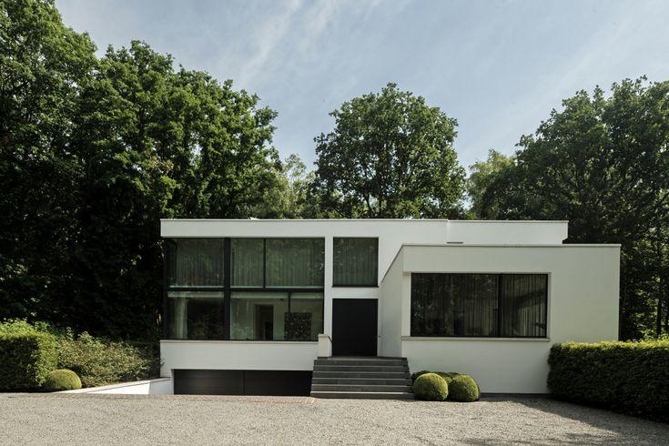 Moderne woning: zwembad en keldergarage - Villabouw Sels
