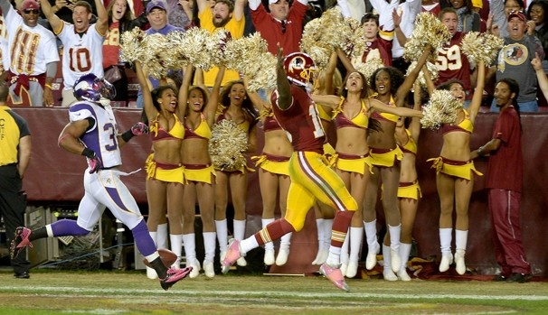 Cheerleaders and fans celebrate as Redskins quarterback Robert Griffin III finishes off a 76-yard touchdown run in the fourth quarter of the team's 38-26 victory over Minnesota on Oct. 14.  Jonathan Newton / The Washington Post