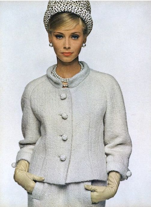1963 Model in chalk-white tweed suit by Ben Zuckerman, hat by Emme, jewelry by Marvella , Vogue
