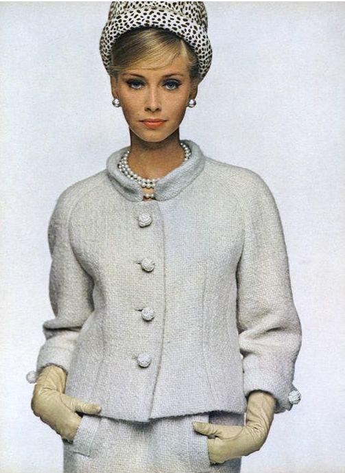 1963 Model in chalk-white tweed suit by Ben Zuckerman, hat by Emme, jewelry by Marvella , Vogue